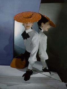 1943 by Horst P Horst    Model is wearing a red cellophane-straw hat, a high-collar white blouse with a black bow at neck from Henri Bendel.