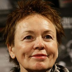 Laurie Anderson was born June 5, 1947 in Wayne, Illinois. One of her early performance art pieces was Automotive (1972), for which she orchestrated car horns. In Duets on Ice, another early piece, she wore ice skates frozen in blocks of ice; she then proceeded to play a duet with herself on an altered violin. To support her work in performance art, she freelanced as an interviewer and art critic.