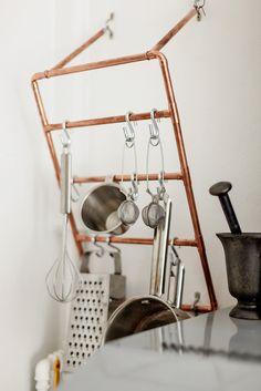 Copper pipes as utensils hanger
