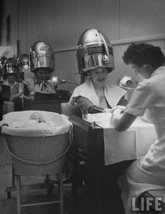 Beauty salon with baby, 1947