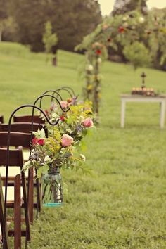 Shepherds hooks + mason jars + flowers. Great for an outdoor wedding AND could take off the hooks and move to an indoor site on the floor of the aisle if it rains.