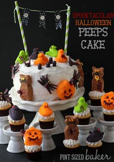 Zombie-fied Peeps on top of a Halloween Cake and Cupcakes. #Halloween #Fun #Peeps