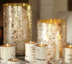 Setting the mood during a the reception with hurricanes & birch wood candles.