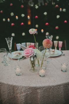 Single florals on blush sequinned linen.