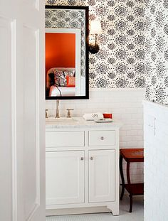 Barrie Benson, Albert Hadley's fireworks wallpaper, black wall mirror, sconces, bath, bathroom, white wall tile