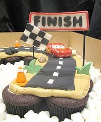 Cars Pull Apart birthday caupcakes. Use the cupcakes to make a road with chocolate icing and white for the lines then just add toy cars on top like they are racing