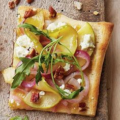 Apple-Goat Cheese Pizza | A green bean and apple sandwich? Trust us on this one. We fell for the combo of tender beans, crisp apples, salty Parm, and tangy dressing. Keep it tidy by hollowing out the baguette to create a cradle for the fillings. | SouthernLiving.com