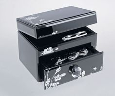 This oriental looking jewellery box from Argos has a stylish black exterior with beautiful floral pattern and will bring charm and character to her dressing table.