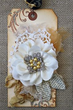 Gorgeously dimensional handmade tag in a lovely pale palette. #flower #shabby #chic #vintage #stamped #tag #handmade #crafts #paper #scrapbooking
