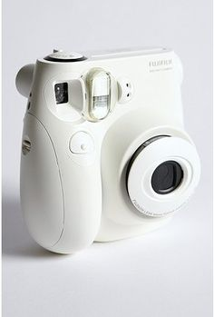 """A new """"polaroid"""", Instax Mini 7S instant camera, credit card sized photos.  Urban Outfitters."""