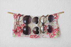 Hang sunglasses on ribbon
