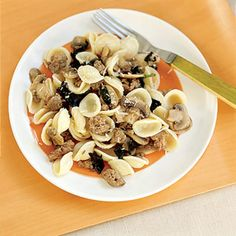 Pasta is tossed with hot Italian sausage, mushrooms, fresh basil, and Parmesan cheese for a simple, but flavor-packed dinner.