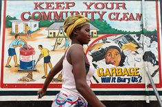 PHOTO OF THE WEEK: 5 March 2013  --  A young woman passes a mural promoting healthy sanitation and hygiene practices, outside the UNICEF-supported Hospital in Monrovia, Liberia. UNICEF supports social mobilization efforts worldwide – encouraging and enabling children, women and men to become active participants in improving their own communities. These efforts remain critical to overcoming lingering challenges and effecting truly sustainable change. ©UNICEF/Asselin www.unicef.org/photography