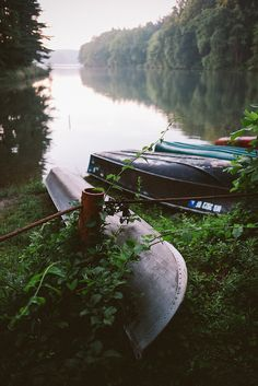 canoes on a still lake