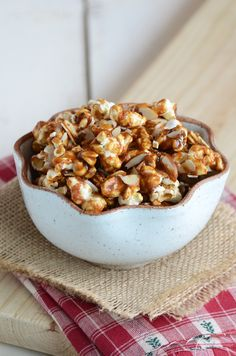 Gingerbread Popcorn (12 cups air-popped popcorn (1/2 cup popcorn kernels), 1 cup toasted sliced almonds, 1 tsp baking soda, 1 tsp cinnamon, 1 tsp ginger, 1/2 tsp nutmeg, 1/4 tsp cloves, 1/2 cup (1 stick) unsalted butter, 1 cup light brown sugar, lightly packed, 2 tbsp molasses, 1 tbsp water, pinch of salt, and 1 tsp pure vanilla extract) - would make a great party favor for Christmas!