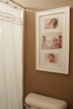 Photos of the kids in the tub on the wall in the bathroom