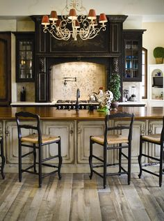 Tudor, rustic, old world kitchen black cabinets.  I LOVE this!  The white washed and dark cabinets. The eat-in island!  The top needs to be open, though.