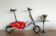 Folding electric bike by Voltitude, table by Eero Saarinen, vases by Philippe Cramer