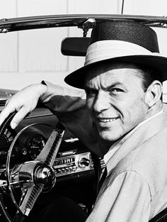Frank Sinatra behind the wheel of his Thunderbird, 1955.