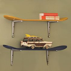 What a great DIY idea using old skateboards. Snowboards would work well too if you have the space and are looking for a wide shelf idea.