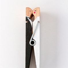 How to make a kissing clothespin couple worthy of a wedding cake topper.