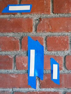Low-impact hanging method.  Apply blue painter's tape (which is easy to remove from most surfaces) to the back of whatever you are hanging as well as the wall on which you wish to hang it. On top of the blue painter's tape attached to the wall, apply double-stick foam tape. Attach what you are hanging to the double-stick tape on the wall. Voila! You will be able to remove or move it at any time. BRILLIANT! :-)