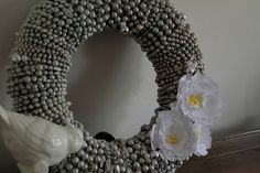 Beautiful wreath made out of Mardi Gras beads?!?  Yes please! Good idea!