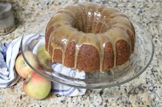 Apple Butter Bundt Cake with Cider Caramel Glaze #bundtbakers Recipe Desserts with all-purpose flour, baking powder, baking soda, ground cinnamon, ground ginger, ground nutmeg, salt, butter, granulated sugar, light brown sugar, large eggs, pure vanilla extract, apple butter, apples, pecans, apple cider, light brown sugar, butter, whipping cream...ooohhhh!  Fall dessert!