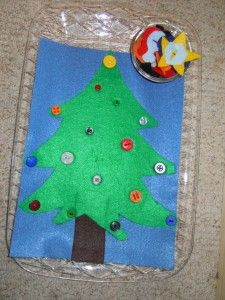 Love this idea - felt christmas tree activity with buttons & felt ornaments that button on.