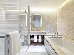 palest creamy marble tiles and soft lighting - contemporary bathroom - EAST Beijing
