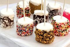 Marshmallow Fun Pops | DIY fun holiday or birthday party craft for kids.  Create snack to match theme with colored chocolate.  Dessert table finger foods.