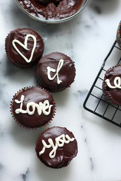 Dreamy Chocolate Cupcakes Filled with White Buttercream and Topped with Chocolate Ganache
