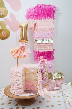 Bright Pink and Gold ruffle cake + tassle pinata