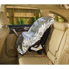 95 degrees in your car? With this powerfully cooling sun shade, you can keep your child's car seat around a comfortable 69 deg F! That's right: in performance tests, the heat-deflecting cover lowered temperatures by an average of 26 deg . With elasticized edge for easy on/off. Folds flat and loops closed for compact storage.