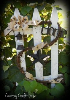 "Decorated picket fence ~by Country Craft House...would be neat to make something similar for foyer table, with maybe a ""Welcome"" sign attached."