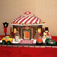Created by Shirley T. of Palm Bay, FL, this Peppermint Diner was created using molded forms from aluminum roof flashing and a pop rivet gun. It is lit inside, and the sign on the roof rotates slowly. It is made entirely of gingerbread, fondant, and candy. | thisoldhouse.com