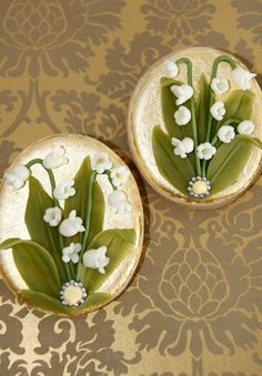 Easter Egg Cookie  Iced cookies covered with 24 carat gold sheets decorated with white chocolate Lily of the Valley flowers and leaves