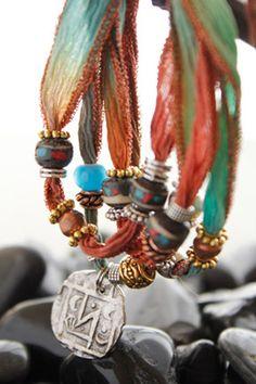 Textured silver medallion, big beads on fiber
