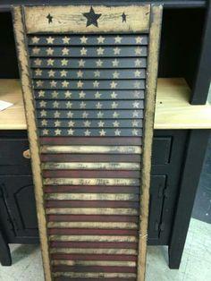 Old shutter painted like flag