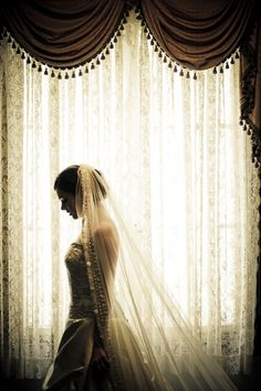 #Bride in a window by Lucero Photography Inc. #wedding #bridal