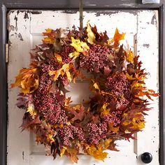 Love our Leafy Fall Wreath? Learn how to make it here: http://www.bhg.com/halloween/outdoor-decorations/pretty-front-entry-decorating-ideas-for-fall/?socsrc=bhgpin082112LeafyFallWreath=17