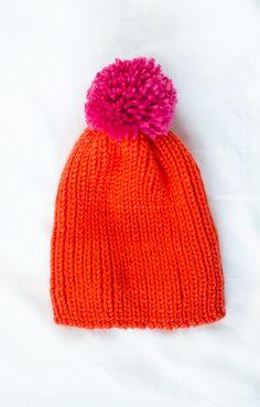 orange pom hat this winter