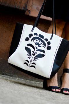 Blogger @FashionablyLo of Fashionably Lo pairs our Laser-Cut Tote with a chic little black dress.