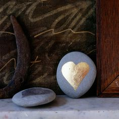 gilded heart on stone