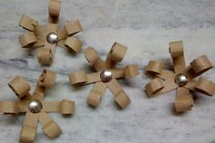 Toilet paper roll flowers.  Cut TP rolls in strips, roll on the ends and add a middle.  Super easy!