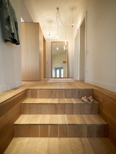"""Athens, Greece, the cradle of classical architecture, is home to this modern renovation of an 810-square-foot apartment. A stairway of white oak, oiled to impart a matte finish, leads into the apartment. The residents left the design decisions up to K-Studio, only requesting that the house have a """"contemporary and calm"""" feeling.  Photo by: Vangelis Paterakis      Read more: http://www.dwell.com/slideshows/slab-house-greece.html?slide=1=y=true#ixzz2CoQIIg7P"""
