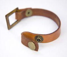 Simple leather cuff. Neat closure idea