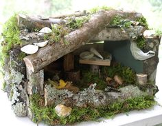 Woodland Fairy House--these small mangers are cheap and easy to find at second hand stores around xmas time.This is a great gift idea !!