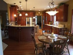 Traditional Cherry kitchen with painted and distressed Island