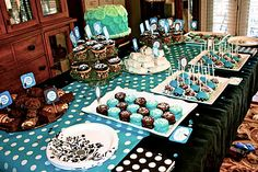 Blue and brown sweet table with cake pops, chocolate covered Oreo's and more.